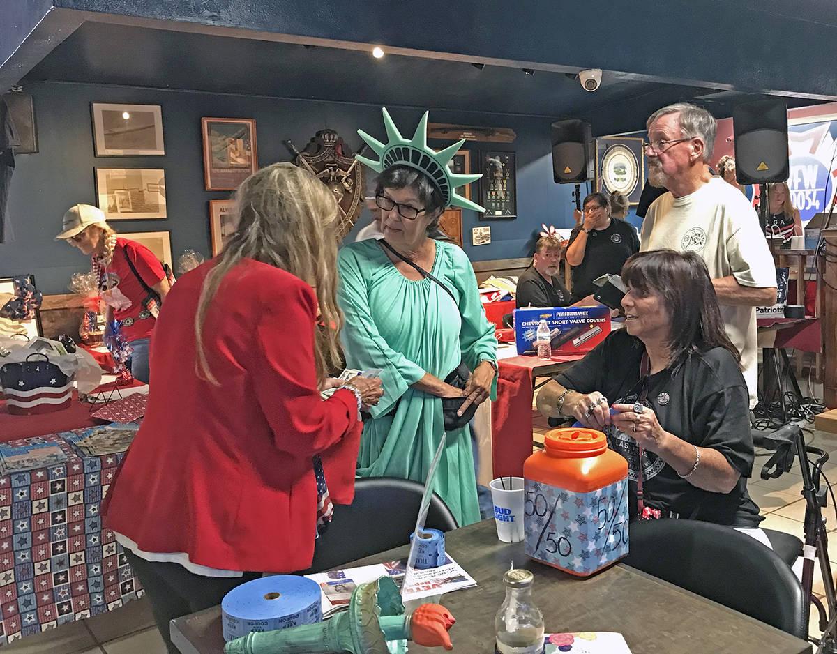 "Robin Hebrock/Pahrump Valley Times ""Lady Liberty"", aka Pamela Morgan, is pictured selling raffl ..."