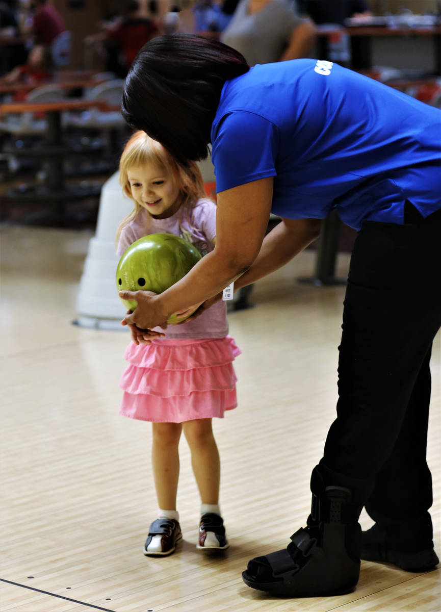 Randy Gulley/Special to the Pahrump Valley Times Bridjette Whaley prepares a young bowler for h ...