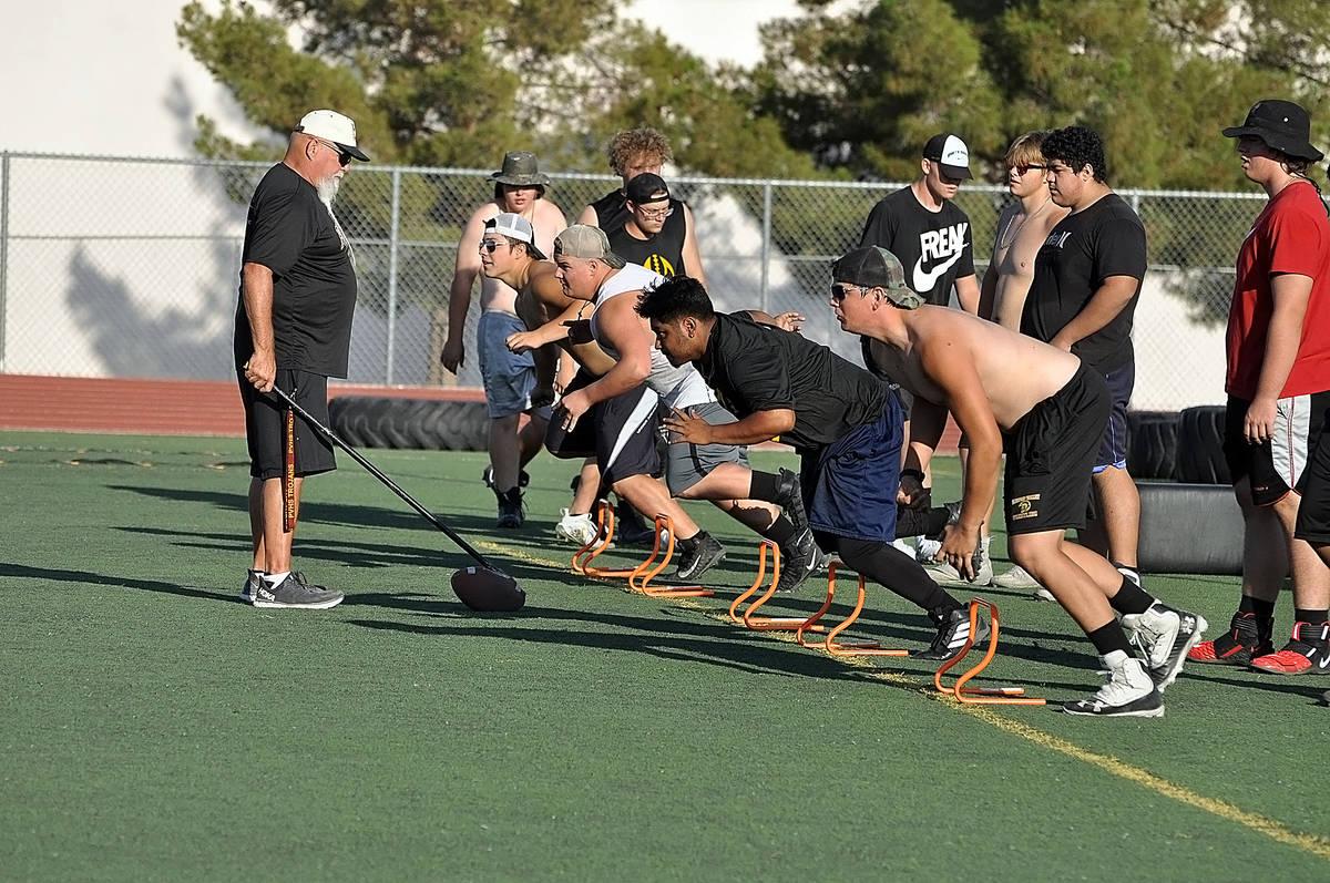 Horace Langford Jr./Pahrump Valley Times Line coach Fred Schmidt runs players through a drill J ...
