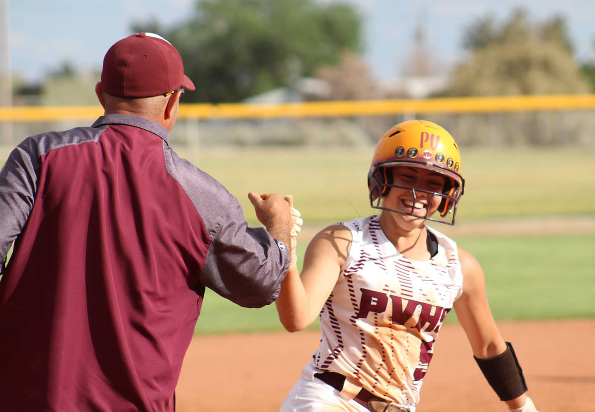 File photo Pahrump Valley High School's Skyler Lauver rounds third to congratulations from fath ...