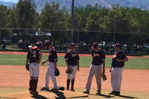 File photo Pahrump baseball players gather near the mound after a pitching change Sunday during ...