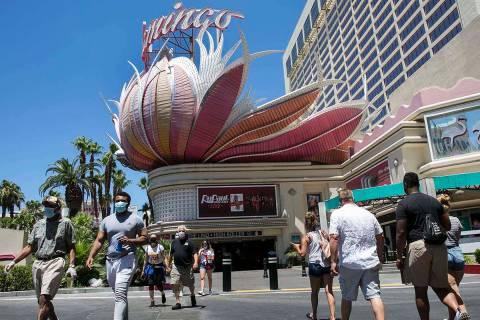 Tourists walk along Las Vegas Boulevard near the Flamingo, July 3, 2020, in Las Vegas. (Bizuaye ...