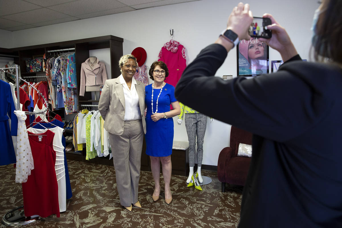 Kenya Mills and Sen. Jacky Rosen, D-Nev., pose for a photo at nonprofit Dress for Success South ...