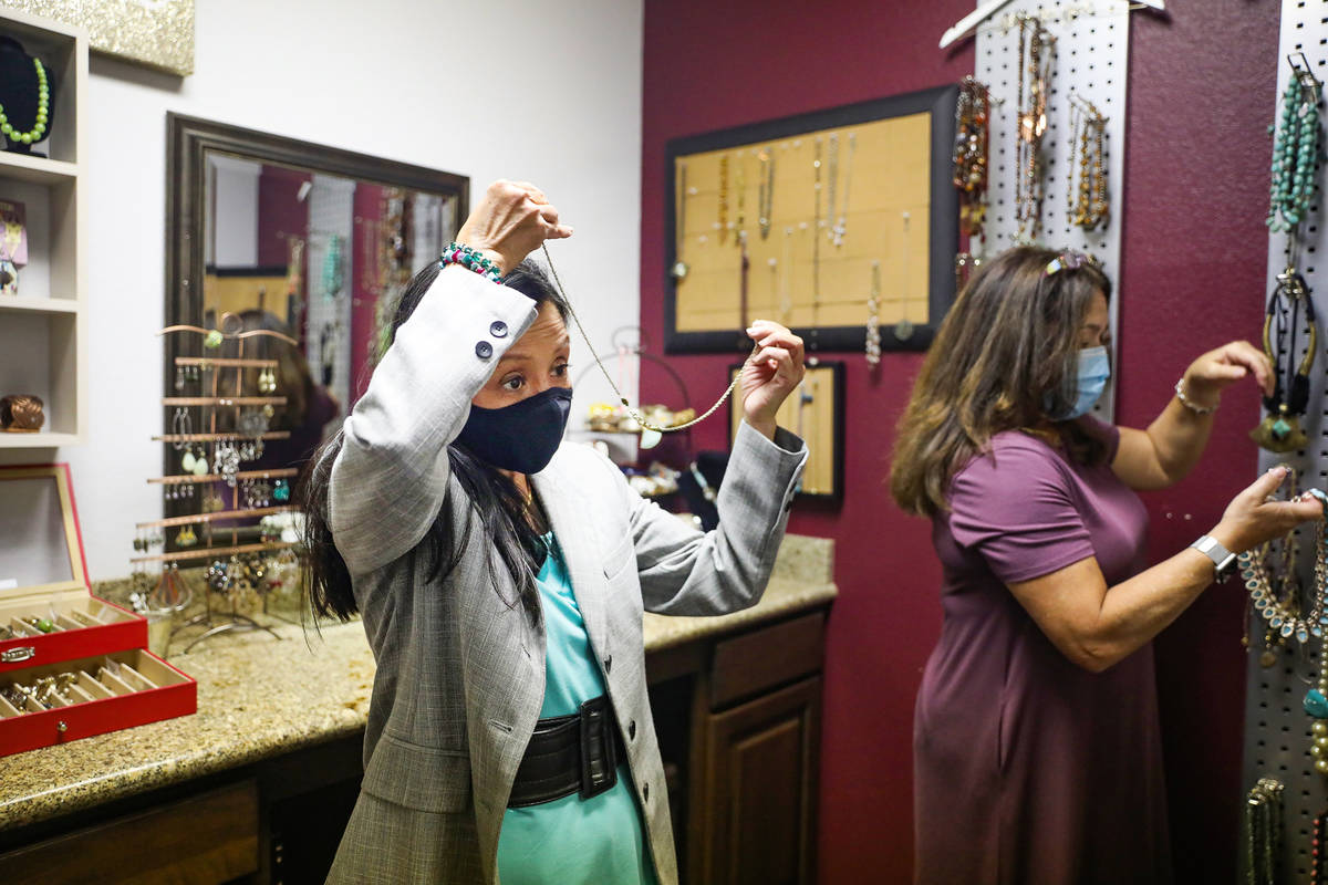 Nancy Sonano, left, tries on a necklace for her outfit with help from stylist Mindi Fasnacht, r ...