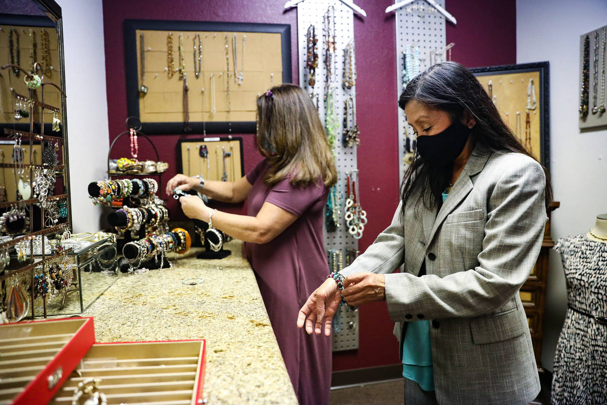 Nancy Sonano, right, tries on a bracelet for her outfit with help from stylist Mindi Fasnacht, ...