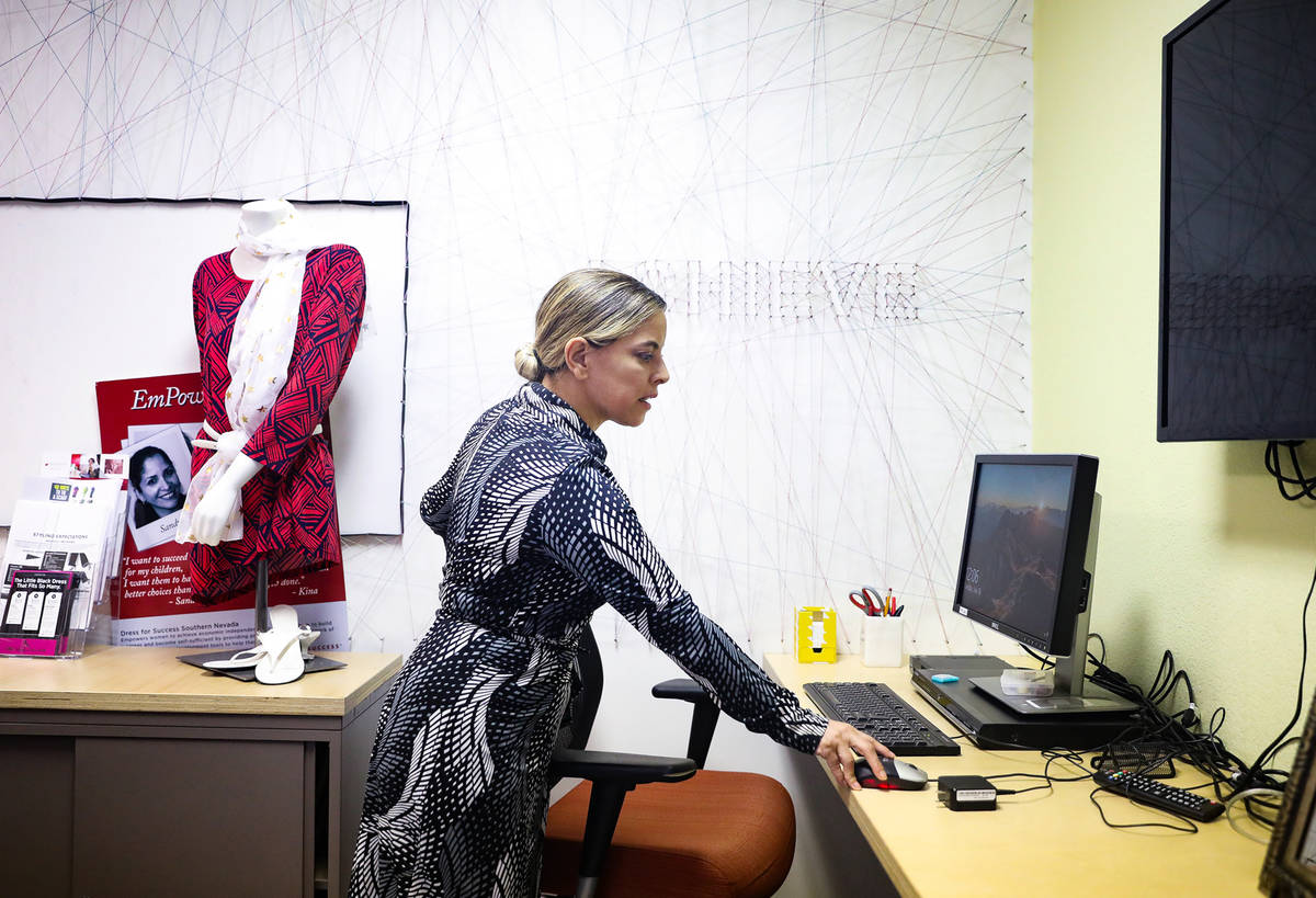Norma Intriago, executive director of Dress For Success of Southern Nevada, shows the Review-Jo ...