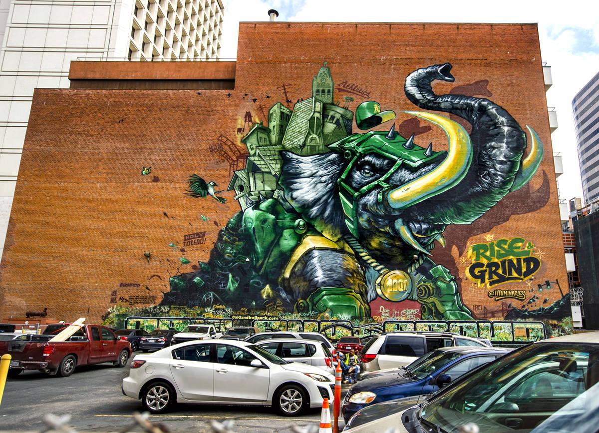 The Illuminaries, a local street art crew, spent three weeks spray painting the 105-foot mural ...