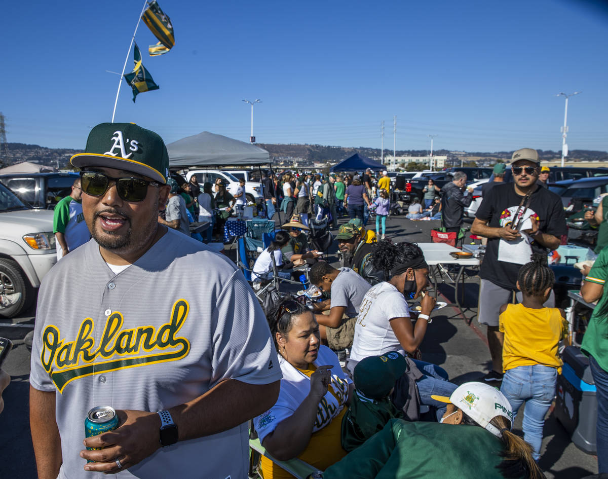 Oakland A's fan Chris Crisolo enjoy a tailgate with family and friends in the parking lot of ...