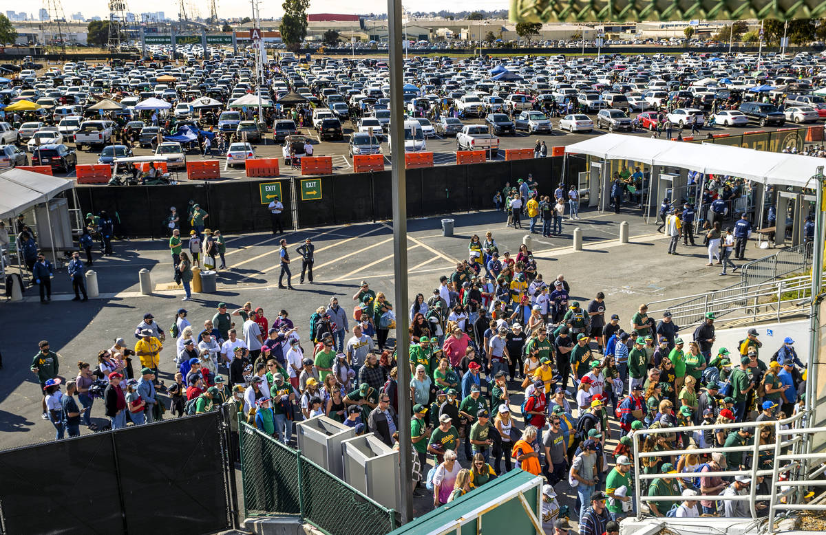 Oakland A's fans pack the entrance to RingCentral Coliseum as they enter to to see their team ...