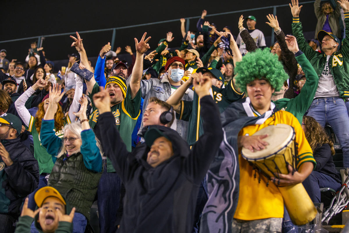 Oakland A's fans cheer as the game goes into extra innings against the Boston Red Sox at Ring ...
