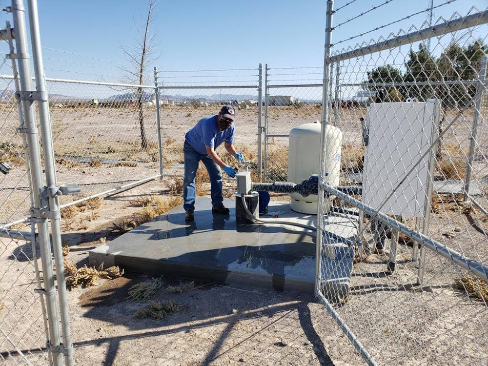 Special to the Pahrump Valley Times Nye County Geoscientist John Klenke is pictured pulling a w ...