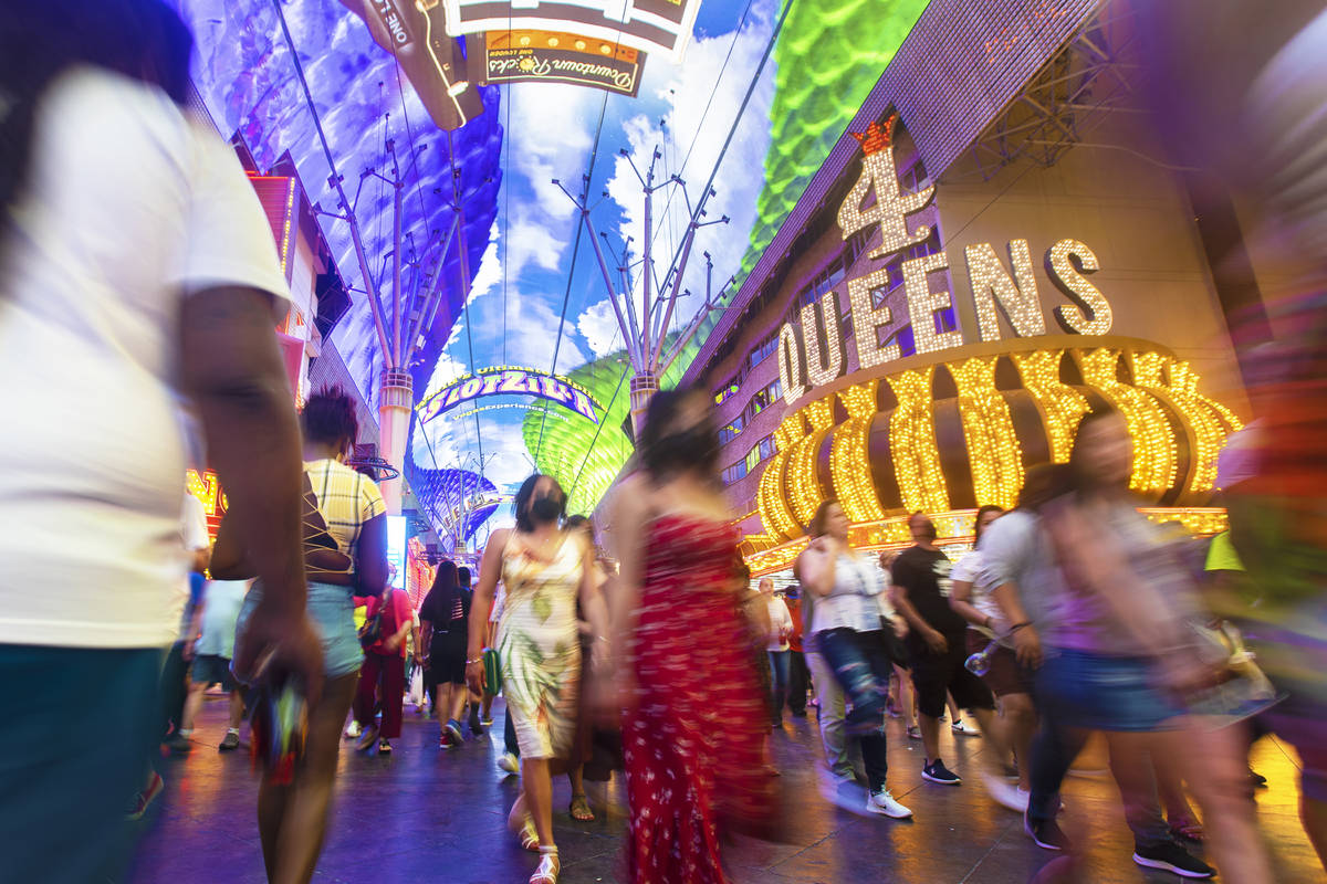 Visitors take in the sights at the Fremont Street Experience during Memorial Day weekend on Sat ...