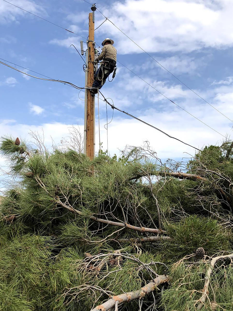 Special to the Pahrump Valley Times Valley Electric offered this photo showing crews addressing ...