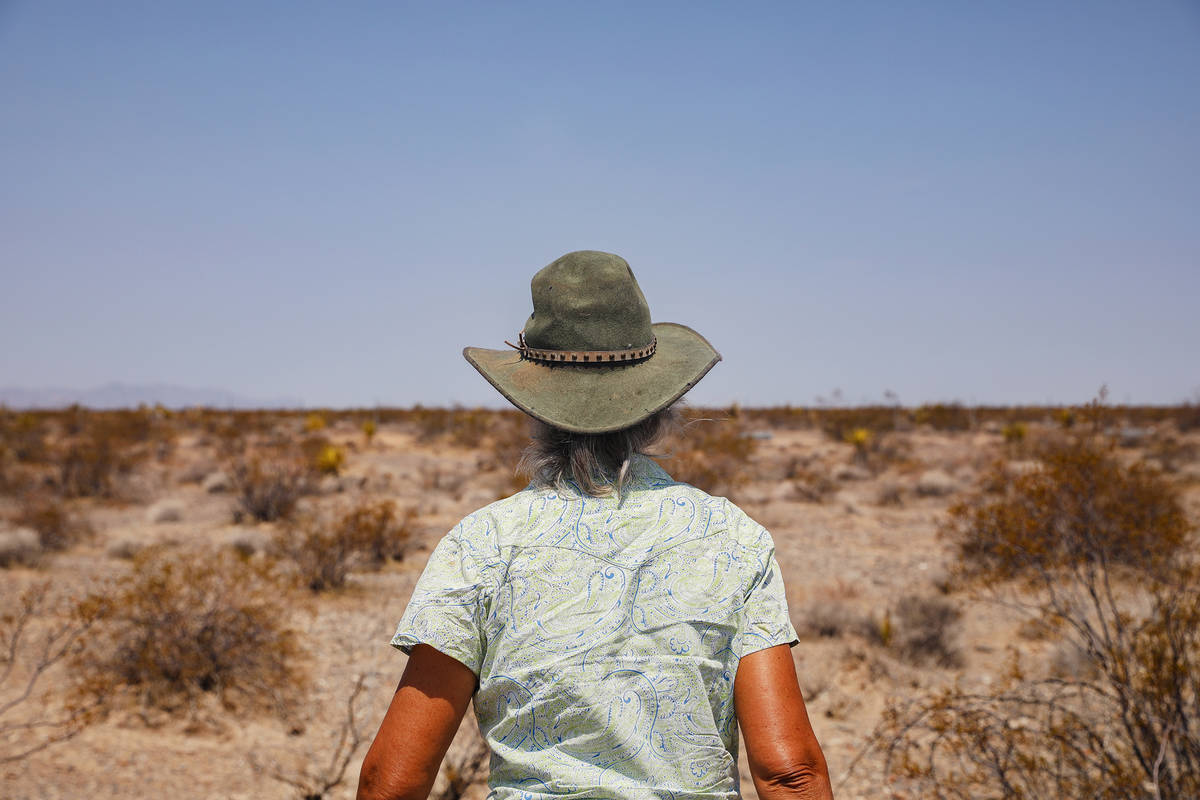 Laura Cunningham walks toward the fence of the future Yellow Pine Solar project, which will cov ...
