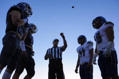 Referee Joe Molinaro flips the coin to decide kickoff between the Green Valley captains, left, ...