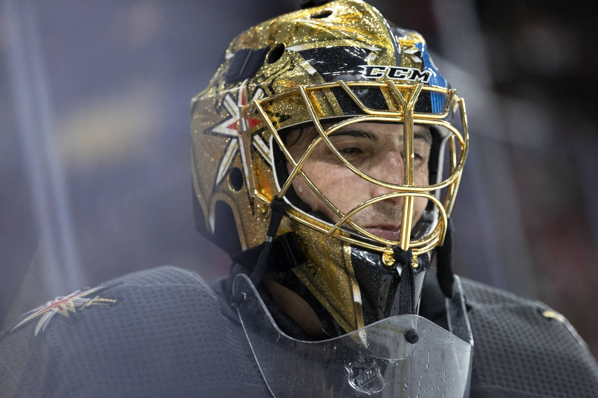 Golden Knights goaltender Marc-Andre Fleury (29) smiles while skating around the net after maki ...