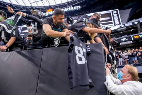 Raiders owner Mark Davis signs autographs for fans before the Raiders home opening pre-season N ...