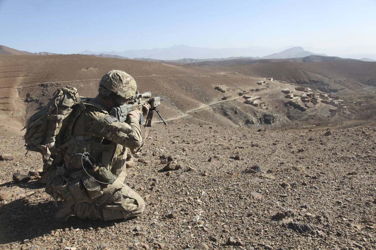 Getty Images U.S. Army infantryman provides security for soldiers patrolling through Dandarh v ...