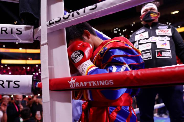 Manny Pacquiao kneels in a corner before the start of the WBA World Welterweight Title bout aga ...