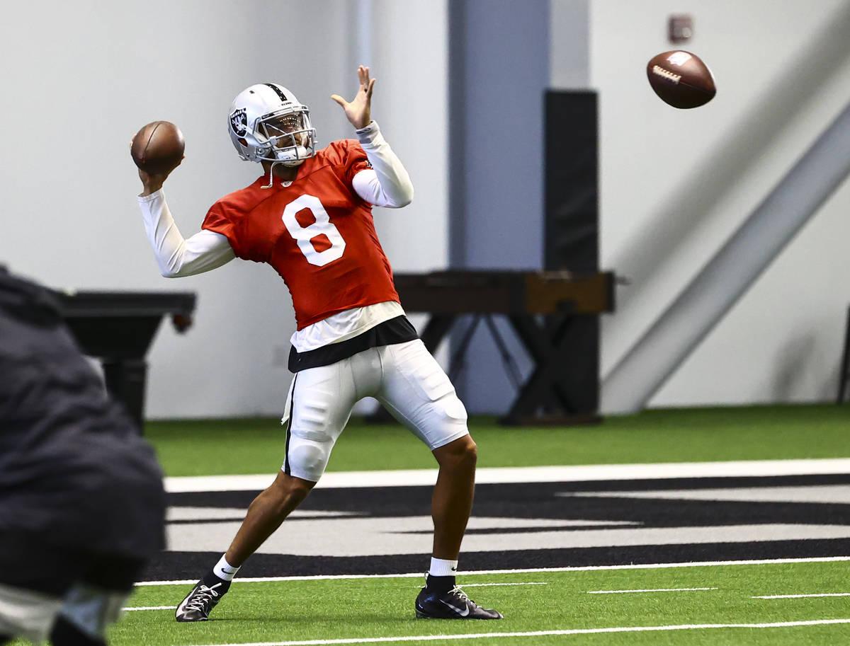Raiders quarterback Marcus Mariota throws a pass during training camp at Raiders Headquarters/I ...
