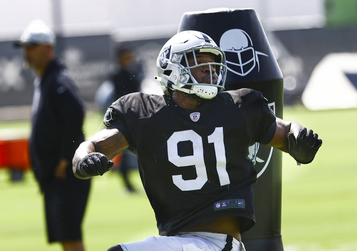 Raiders defensive end Yannick Ngakoue participates in drills during training camp at Raiders He ...