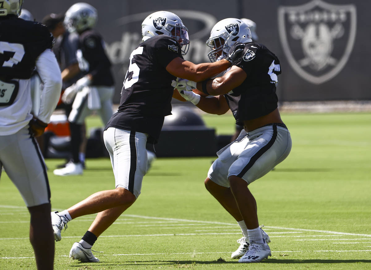 Raiders linebackers Tanner Muse, left,and Max Richardson participate in drills during training ...