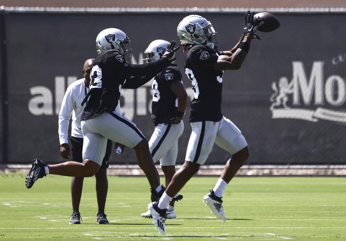 Raiders safety Roderic Teamer, left, and cornerback Nate Hobbs run through drills during train ...