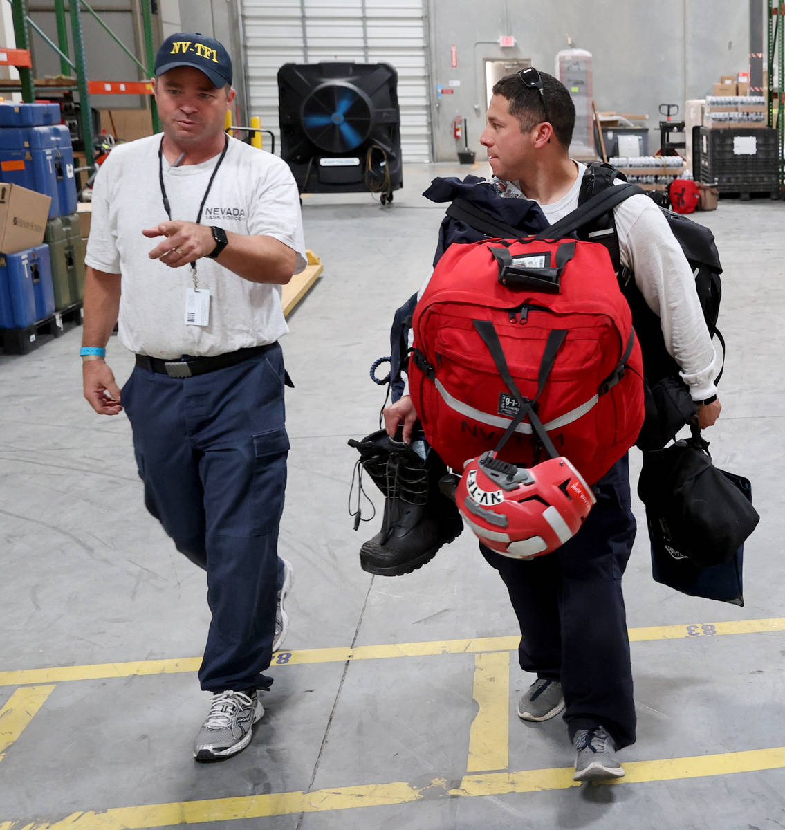 Members of the FEMA Nevada Task Force 1 Urban Search & Rescue team, including Henderson Fir ...