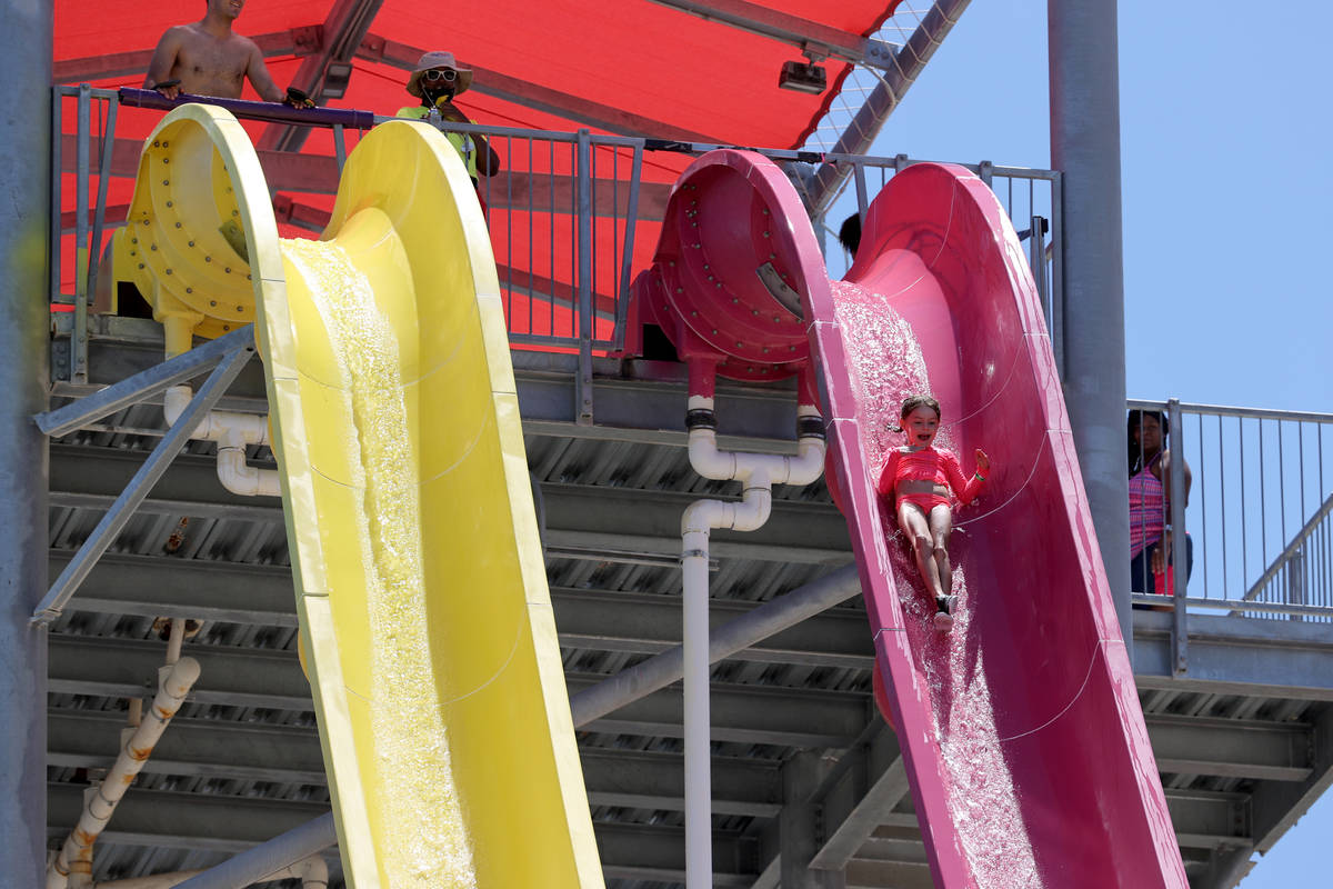 Georgia Scarlett, 6, of Las Vegas rides on Canyon Cliffs on opening day at Wet 'n' Wild water p ...
