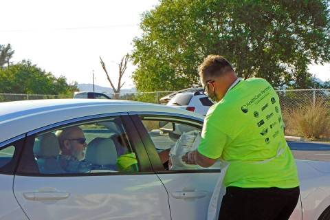 Robin Hebrock/Pahrump Valley Times A volunteer at the Remote Area Medical Taco Dinner drive-thr ...