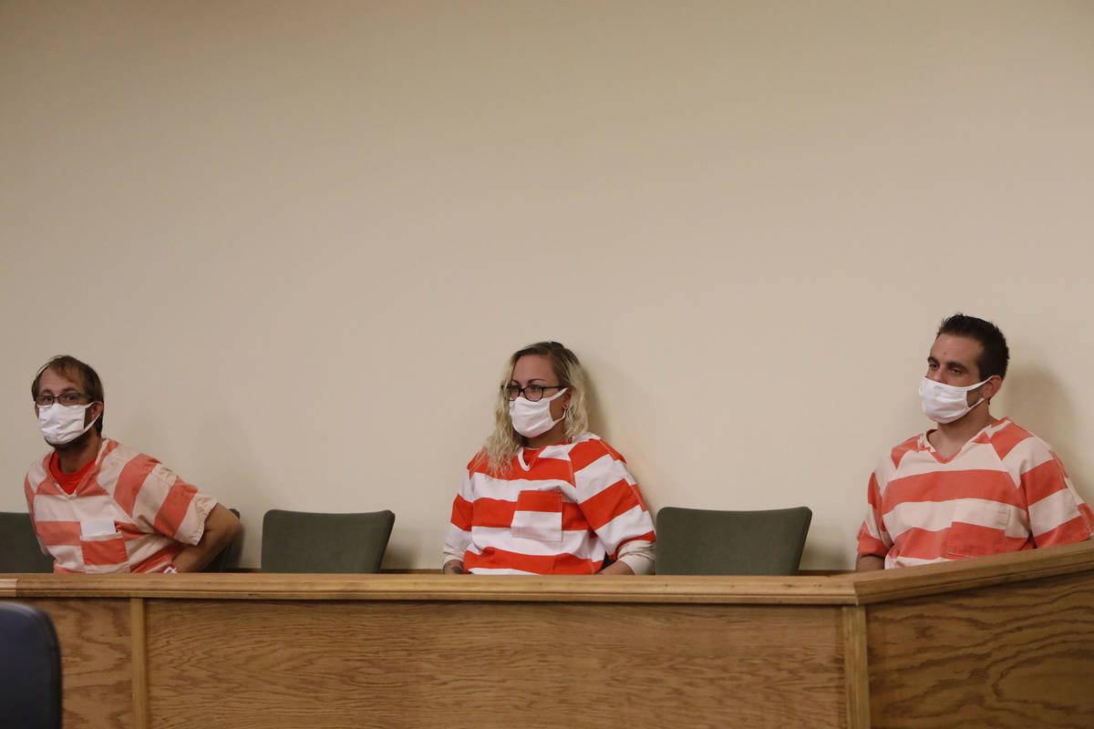 Brad Mehn, from left, Heather Pate and Kevin Dent attend a hearing at Pahrump Justice Court on ...