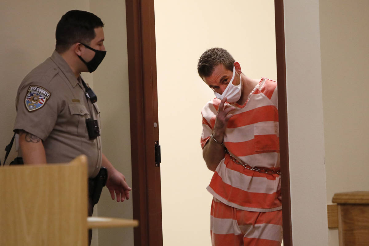 Kevin Dent, right, enters the courtroom for his hearing at Pahrump Justice Court on Thursday, S ...