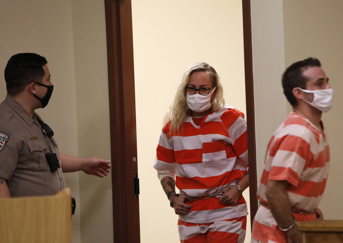 Heather Pate, center, and Kevin Dent, right, enter the courtroom for their hearing at Pahrump J ...