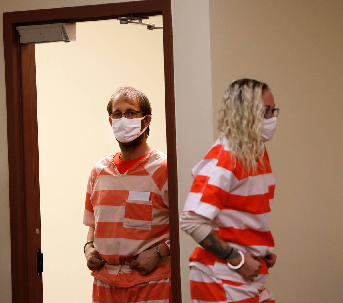 Brad Mehn and Heather Pate enter the courtroom for their hearing at Pahrump Justice Court on Th ...