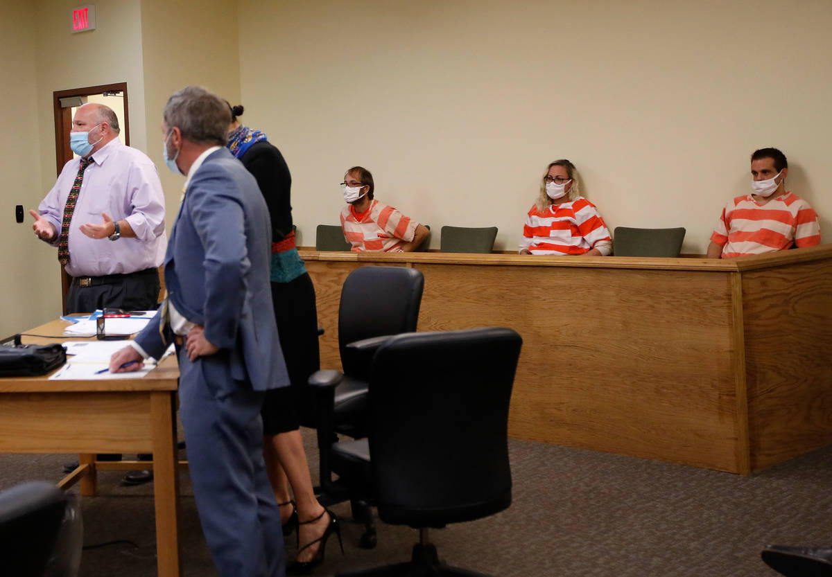 Brad Mehn, background from left, Heather Pate and Kevin Dent listen to Dent's attorney, Jason E ...