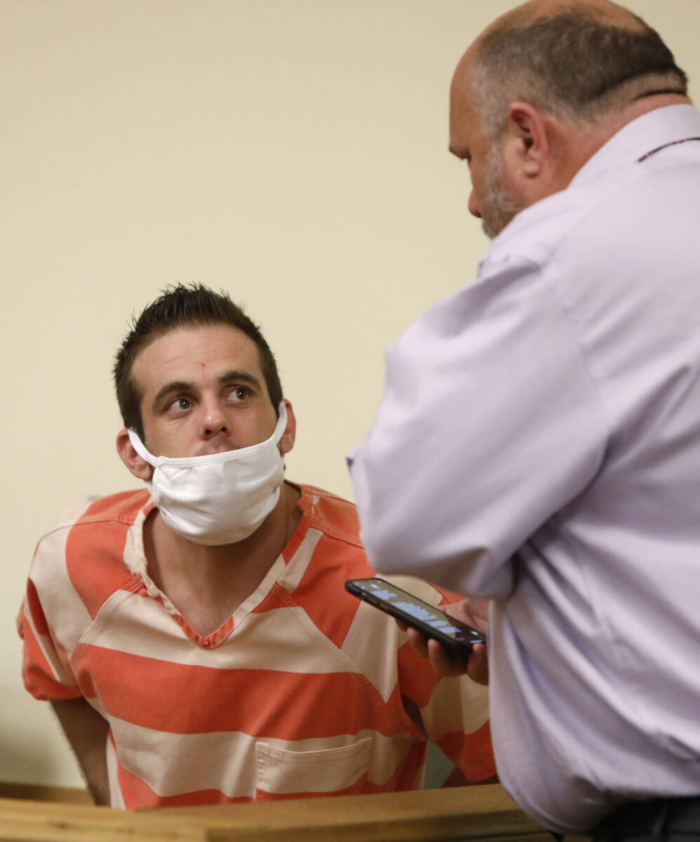 Kevin Dent, left, listens to his attorney, Jason Earnest, during a hearing at Pahrump Justice C ...