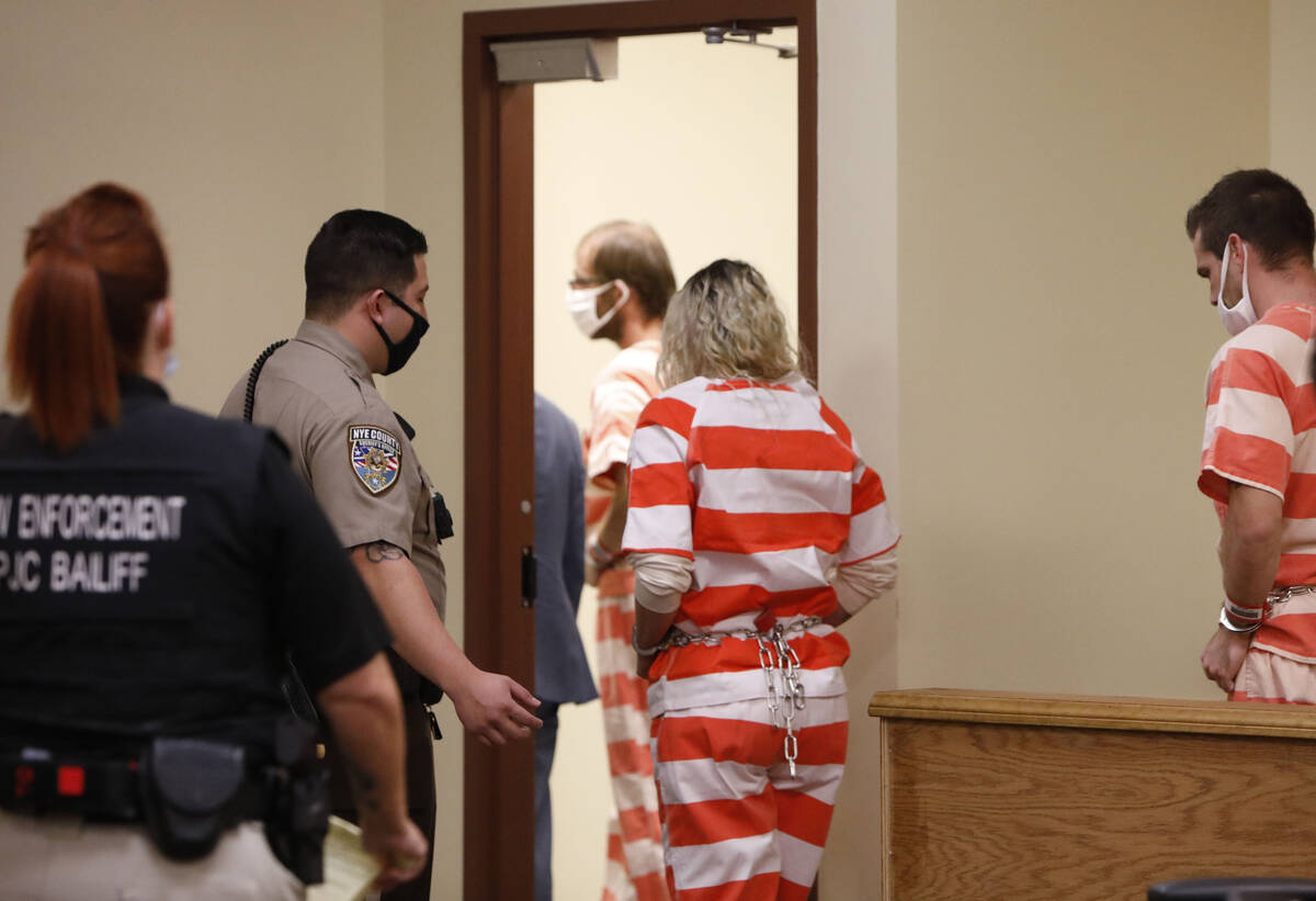 Brad Mehn, Heather Pate and Kevin Dent leave the courtroom after attending their court hearing ...