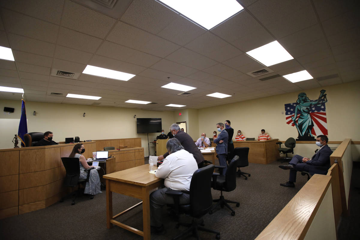 Pahrump Justice of the Peace Kent Jasperson, far left, listens to prosecutor Kirk Vitto, second ...