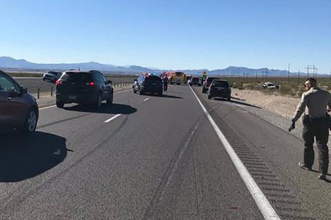 Law enforcement officers investigated a fatal two-vehicle crash on State Route 160 near Pahrump ...