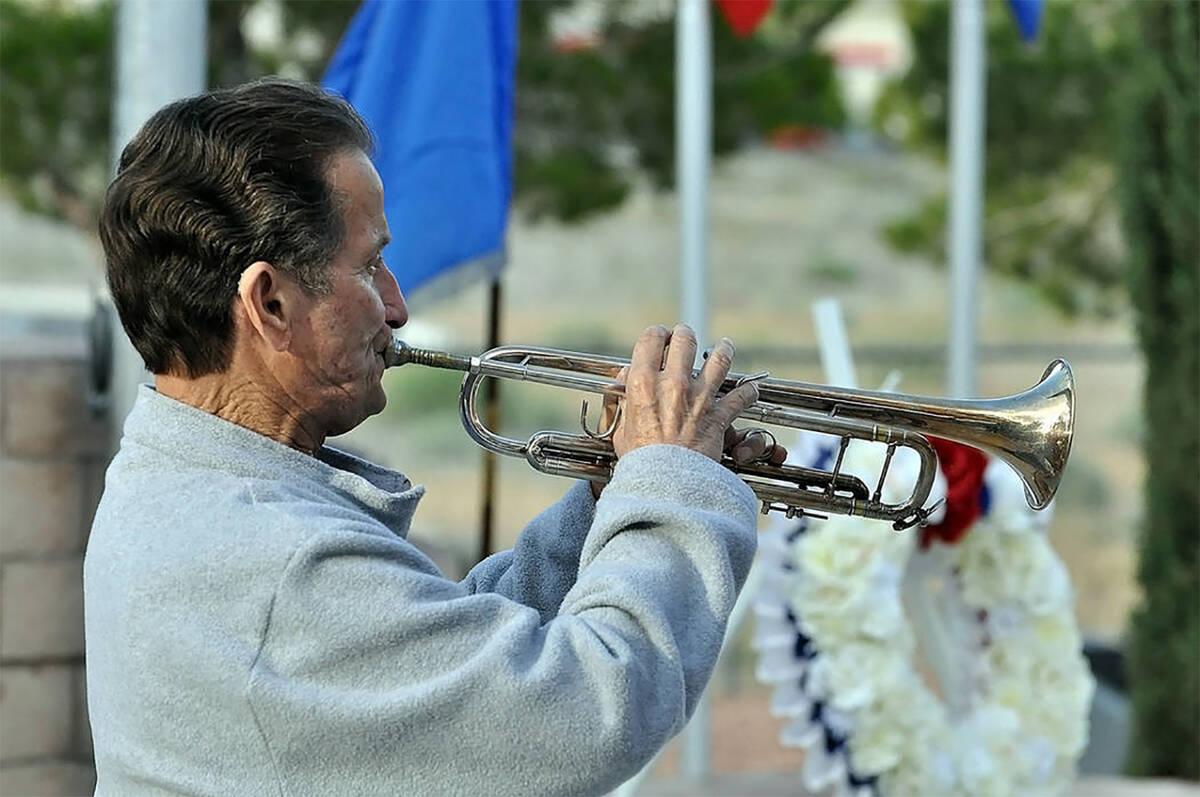 "Horace Langford Jr./Pahrump Valley Times Tom Saitta performs ""Taps"" during the annual Pahrump D ..."