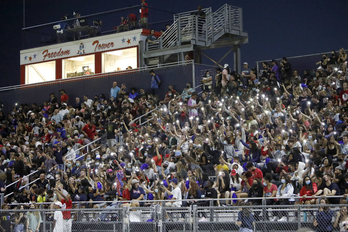 Liberty High School fans cheer during the first half of a football game against Arbor View High ...