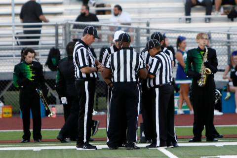 Officials, from left clockwise, head linesman Jon Spalding, referee Shane Lewis, white cap, ba ...