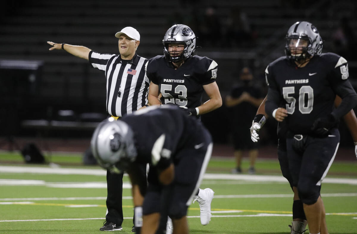 Referee Shane Lewis gestures during the first half of a football game between Palo Verde High S ...