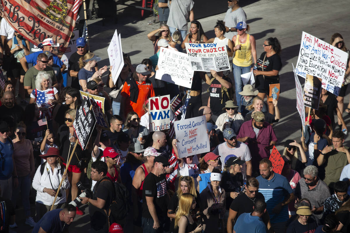 Demonstrators congregate outside Planet Hollywood during an anti-mask, anti-vaccination and fre ...
