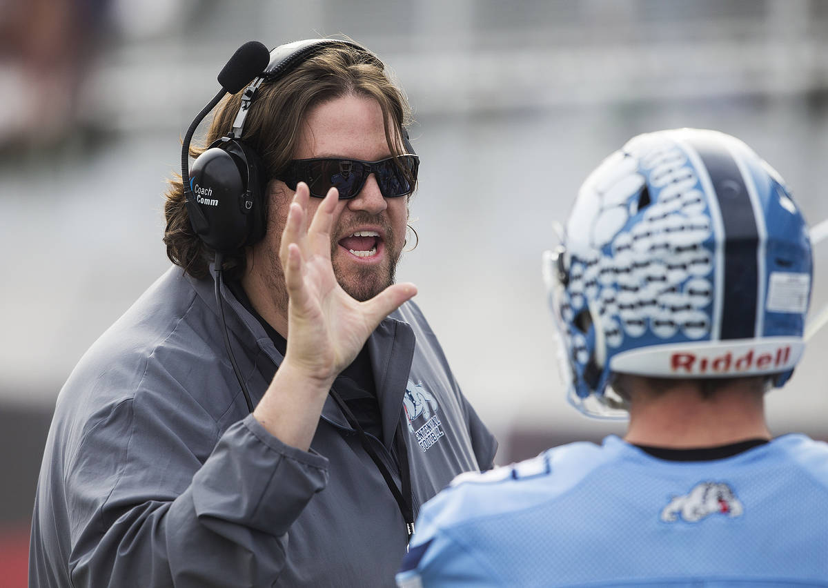Centennial head coach Dustin Forshee coaches up his players in the first quarter during the Cla ...