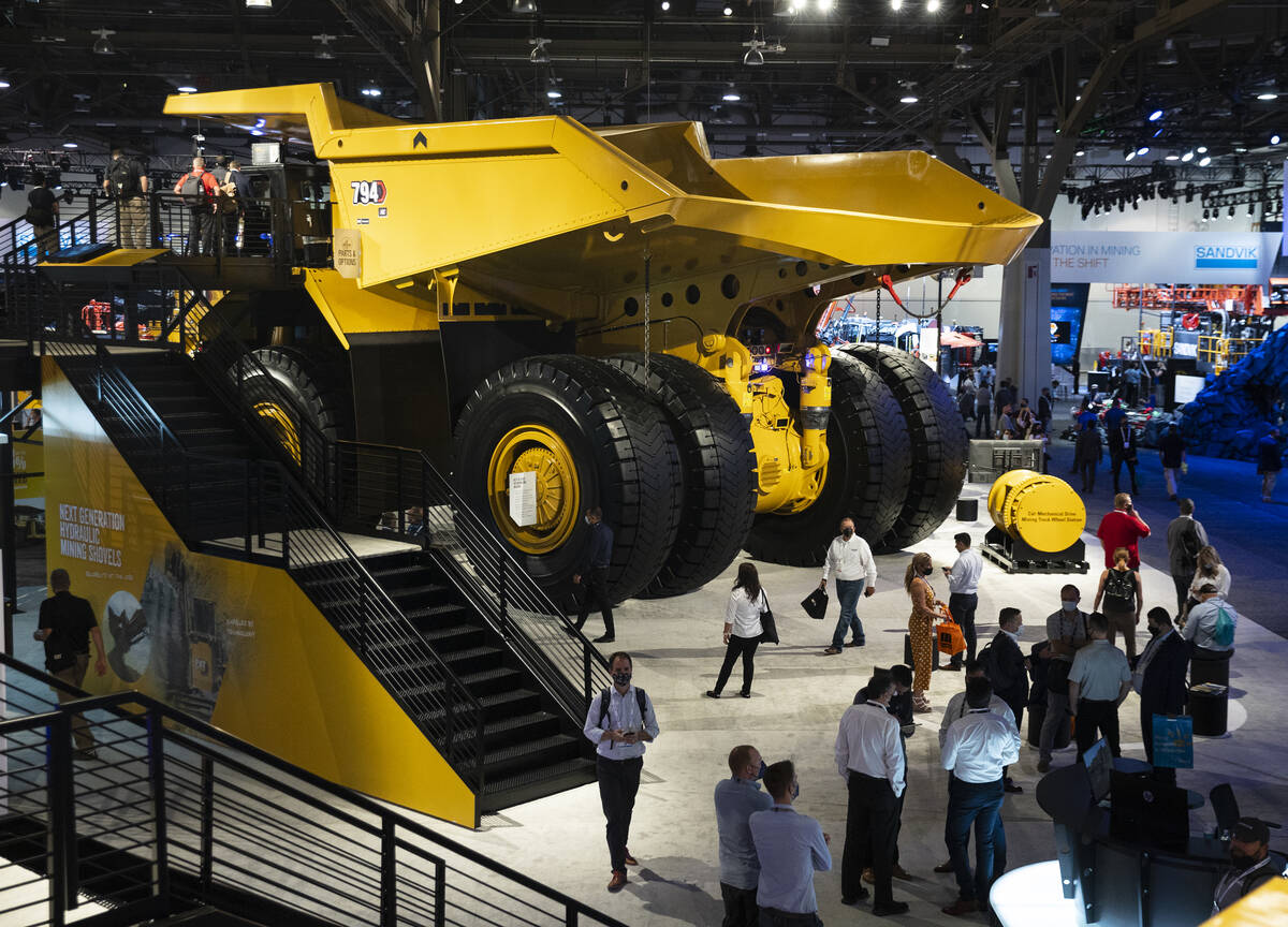 CAT 794 AC mining truck is displayed at Caterpillar booth during the opening day of the Nationa ...