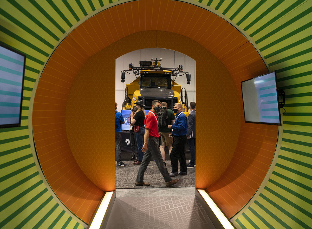 Expogoers check out Bell B45E dump truck during the opening day of the National Mining Associat ...