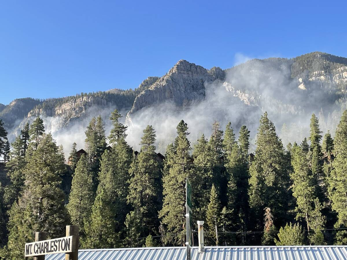 Smoke can be seen from a fire that damaged the lodge at Mount Charleston on Friday, Sept. 27, 2 ...