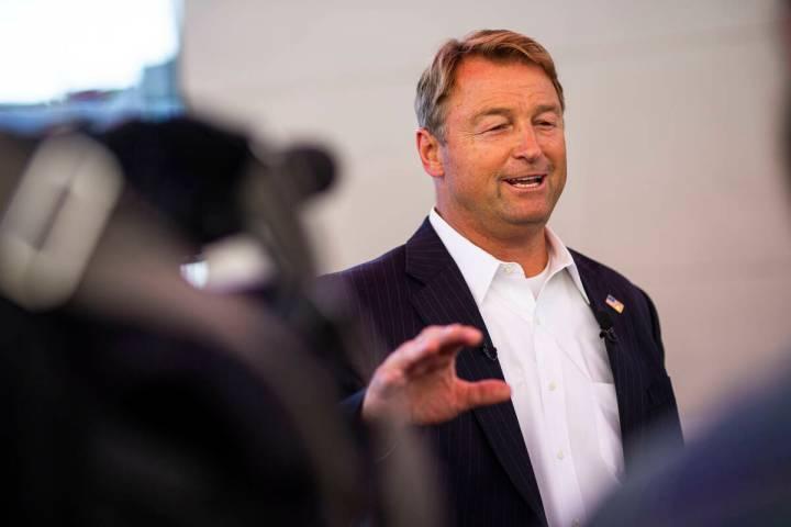 Chase Stevens/Las Vegas Review-Journal Former U.S. Sen. Dean Heller talks with members of the n ...