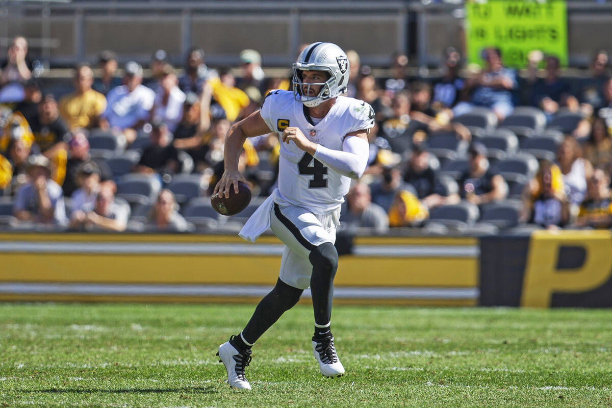 Raiders quarterback Derek Carr (4) scrambles with the football during the third quarter of an N ...
